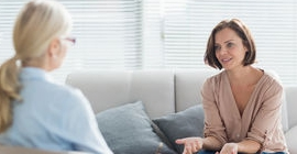 Two people in a mental health interview